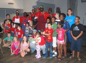 Basketball team spends time with children