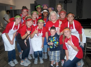Lee College Lady Rebels pose while volunteering at Curt's Kitchen