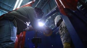 Two welders working on a project