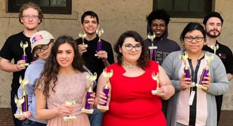 Debate team with awards after Baton Rouge win.