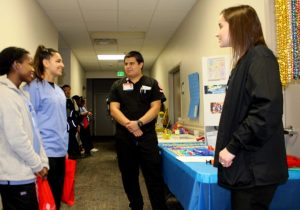 Sterling High School juniors Yasmeen Washington and Krislynn Salazar learn about the negative effects of marijuana from Lee College nursing students Leonel Aramburo Jr. and Ashlyn Scheller.