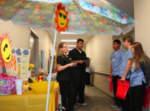 Lee College nursing students Jennifer Hernandez and Mike Garza share sun safety information with Sterling High School juniors Jose Marquez, Canaan Hanson and Carol Davis.